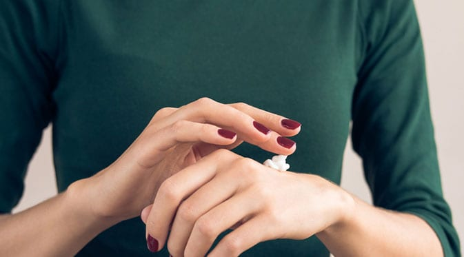 female moisturizing hands