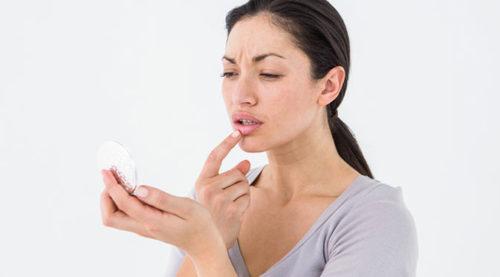 woman touching lip