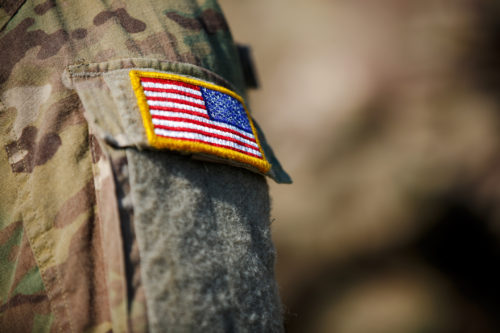 american flag patch on soldiers sleeve